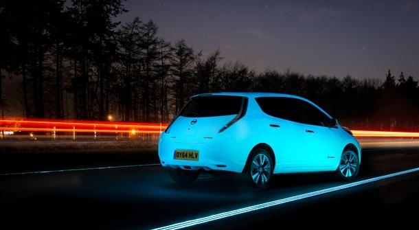 A shiny Nissan on a shiny road