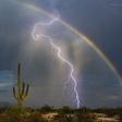Amazing: Lightning and Rainbow Captured Together