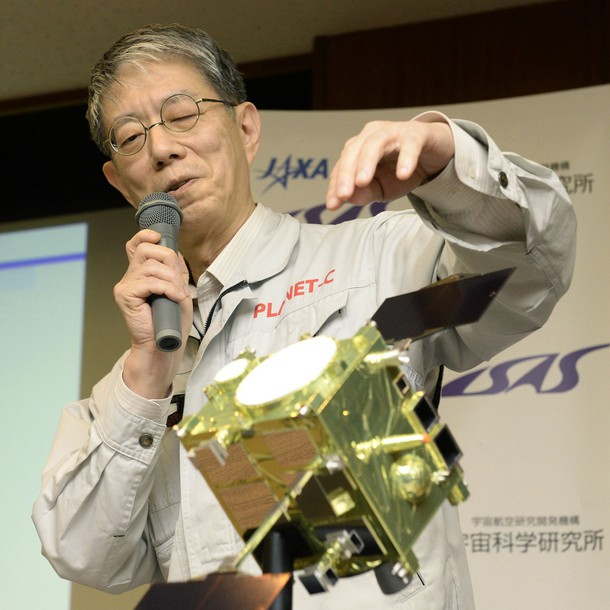 Masato Nakamura, professor at the Japan Aerospace Exploration Agency, meets with reporters in front of a model of its probe Akatsuki.