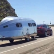 How much impact does the trailer have on Tesla X's range?