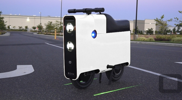 Riding the box-like electric scooter