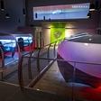 Real-like racing: a racing simulator with world's first 200º wrap around screen