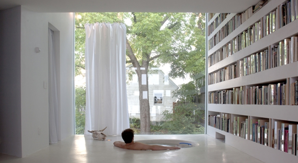 Sunken in a tub and surrounded by books