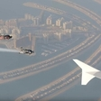 Daredevils fly with the Emirates A380 over Dubai