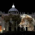 Public art projection featuring images of climate change to illuminate St. Peter's Basilica
