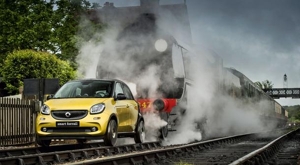 A Smart car transformed into a train