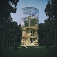 A tubular glass tree-hugging house