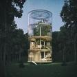 A tubular glass tree-hugging house