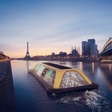 Cruising on the Seine on a workout-powered gym boat