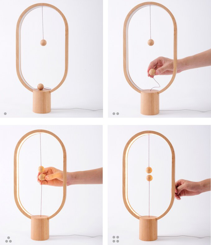 Heng Balance Lamp Is A Unique Wooden Lamp With Switch In Mid Air